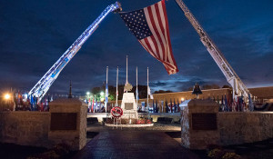 FF Memorial ladder trucks with flag by Bill Green for the NFFF