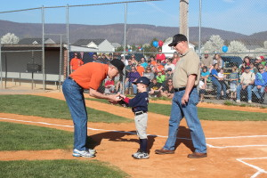 Dr. Love, Greg Eyler and his grandson after opening pitch